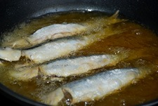 Freír las sardinas